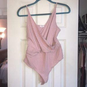 NWOT Pink cross front body suit